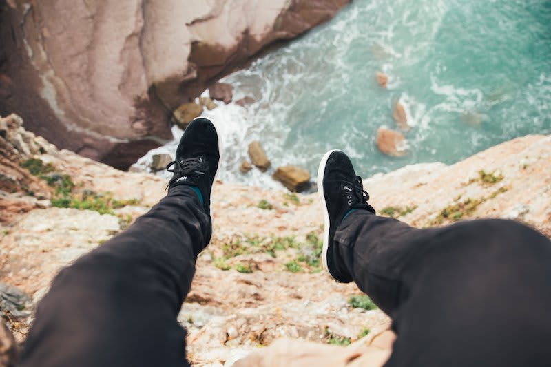 Sneakers in contrast to an ocean view