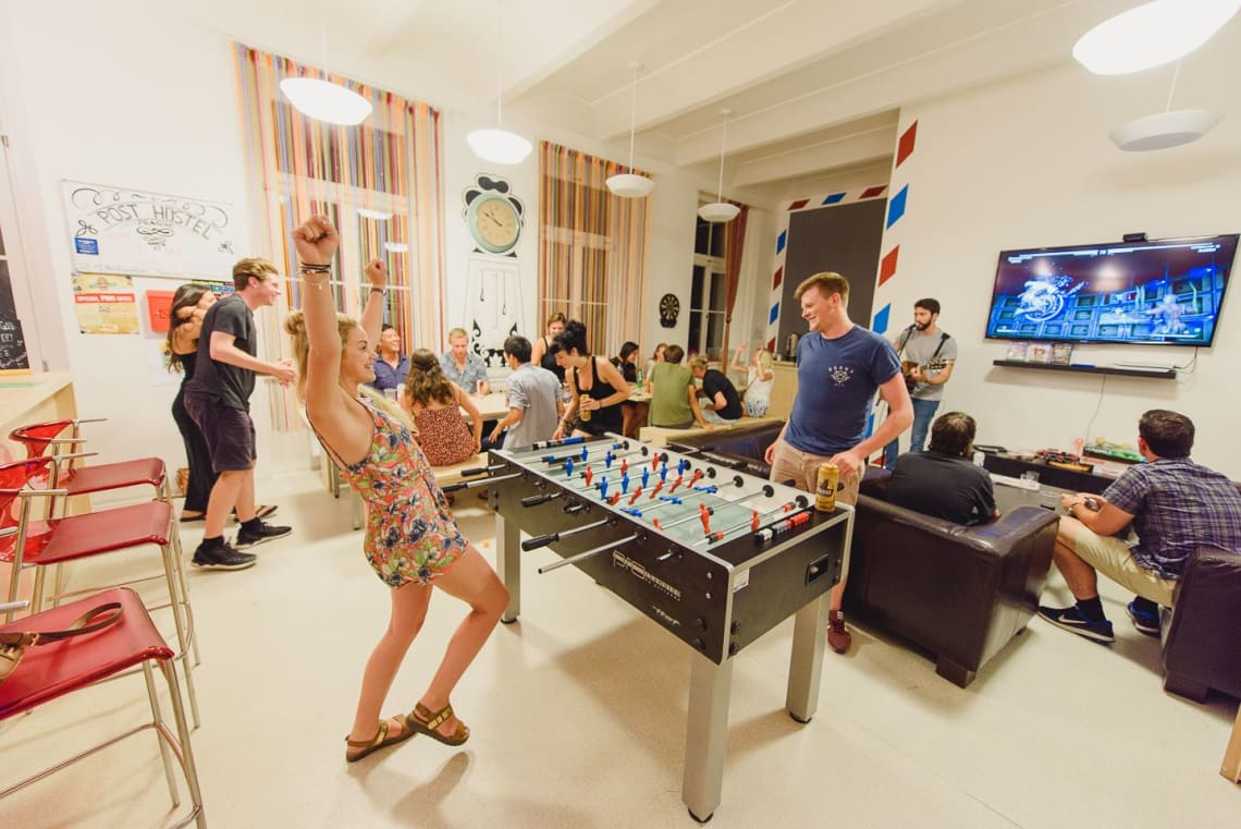 hostel guests enjoying free time with staff and volunteers