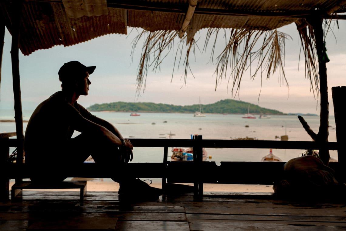 Lone traveler enjoying a beach view, Thailand