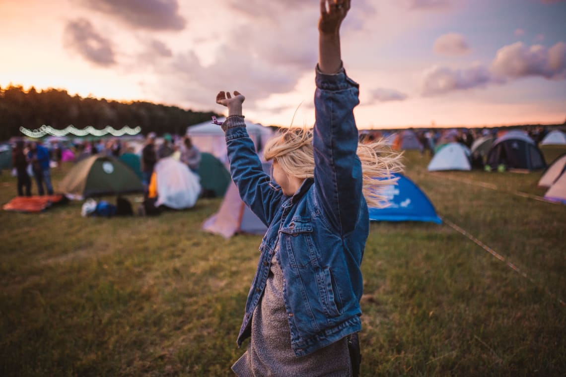 Solo female traveler at an outdoor camping festival