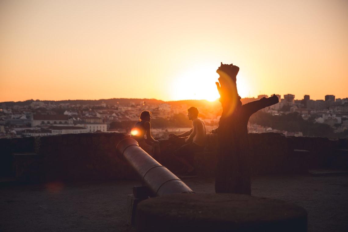 Travelers conversing at sunset