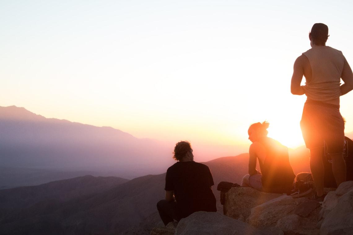 Travelers enjoying a sunset hike, Joshua Tree, California