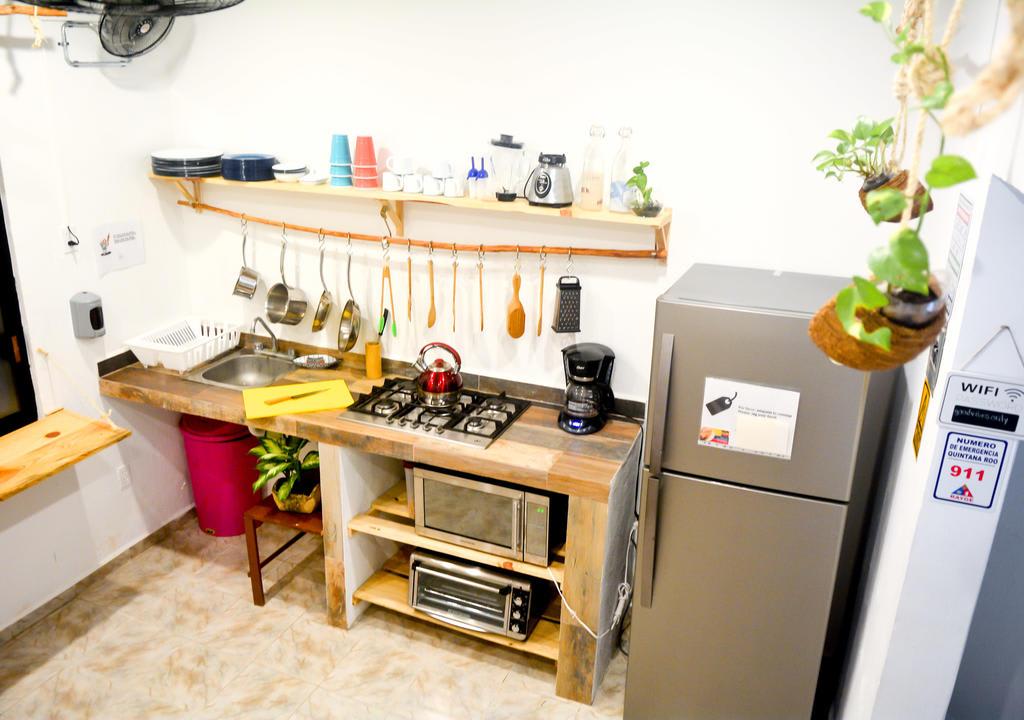 Para economizar com o gasto de alimentação na viagem, uma solução é cozinhar no hostel