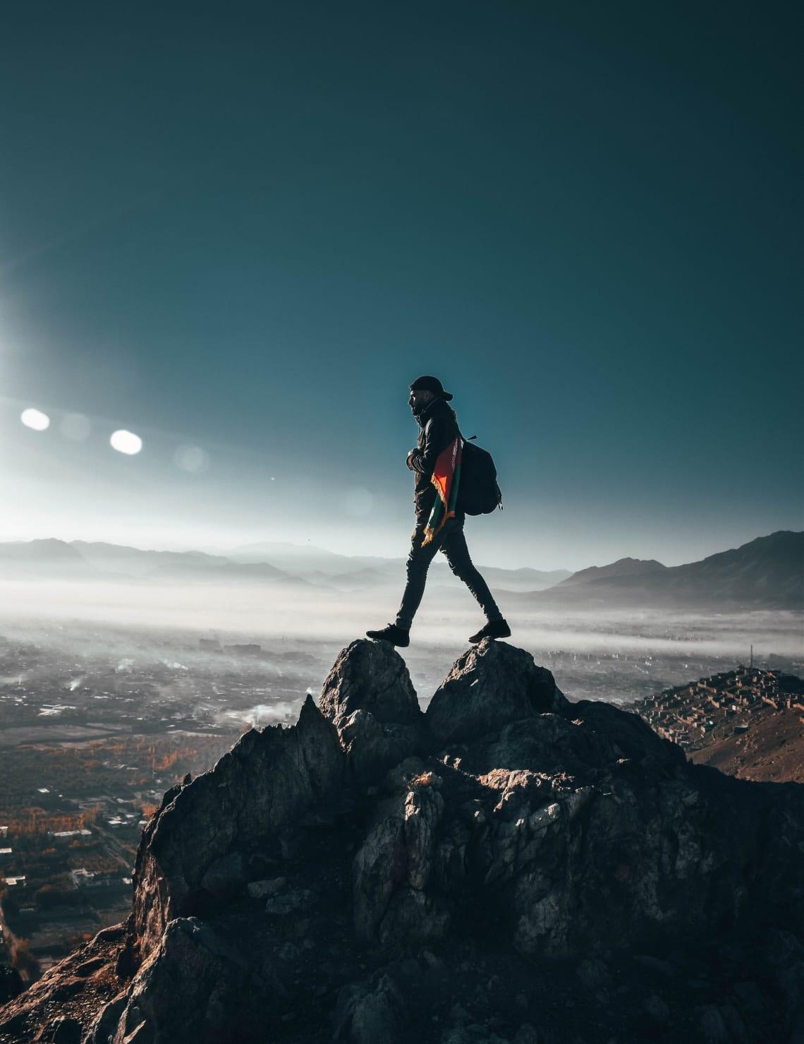 Solo adventurer on a mountaintop