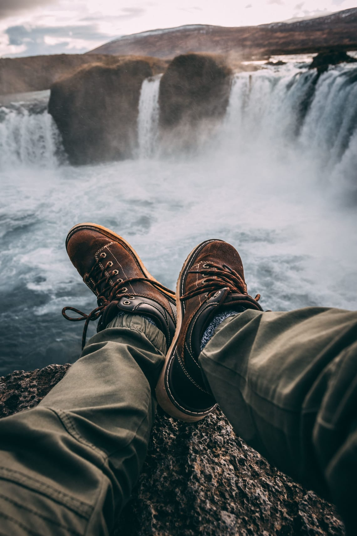Hiker enjoying a rest stop with waterfall views