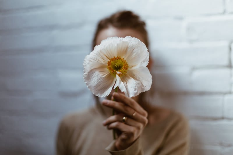 Woman with a blooming flower