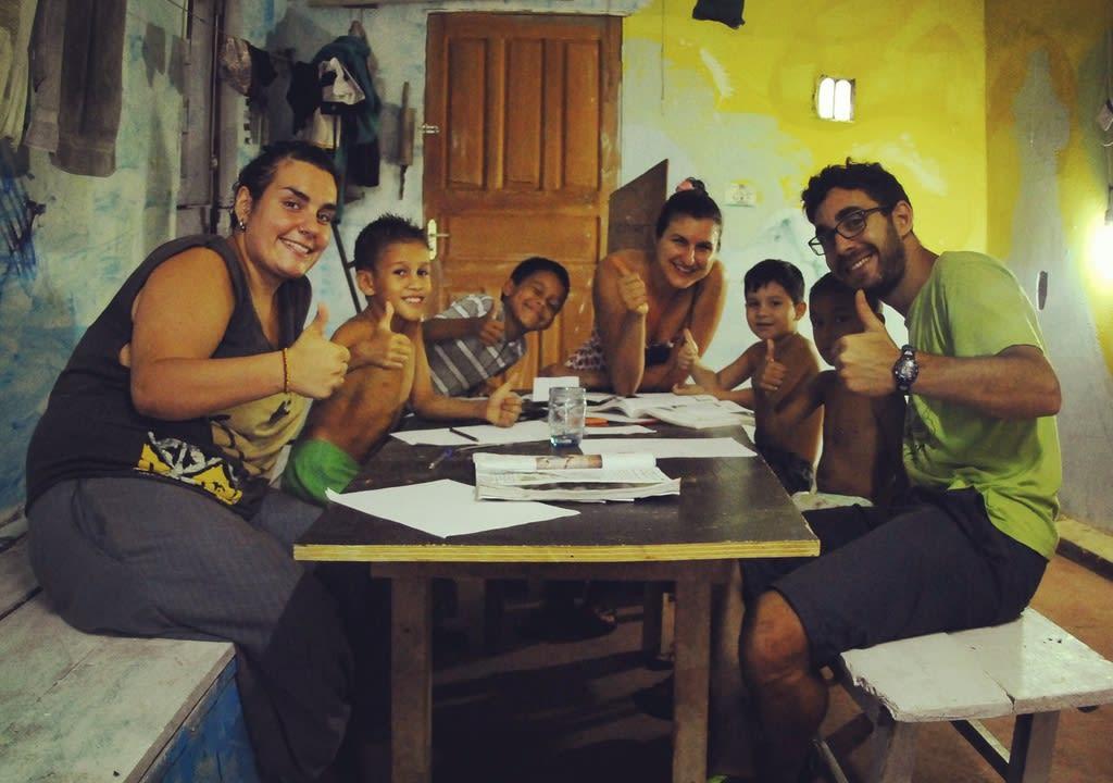 volunteers teaching children in amazonia, brazil