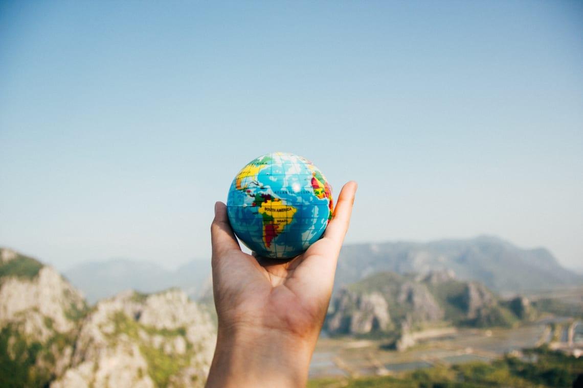 Holding a world globe