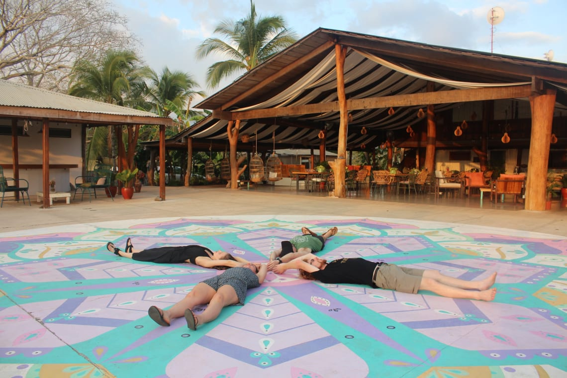 Travelers embracing mindful living practices at an intentional community
