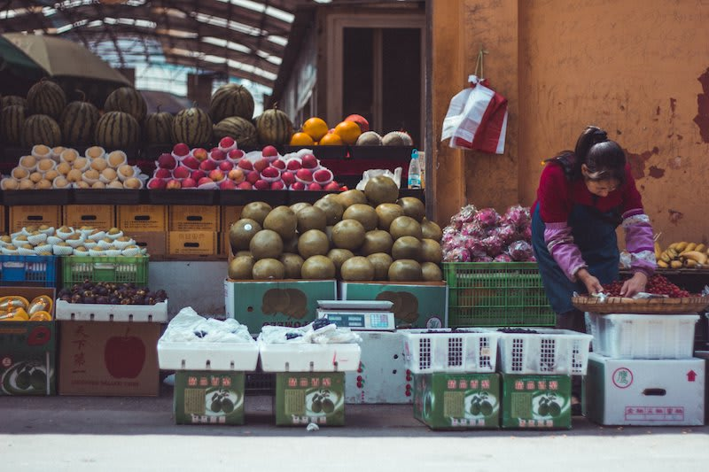 Woman selling fruit at a local market