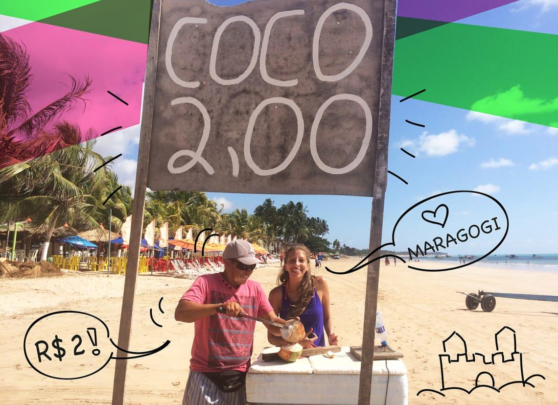 Mulher comprando coco na praia de Maragogi