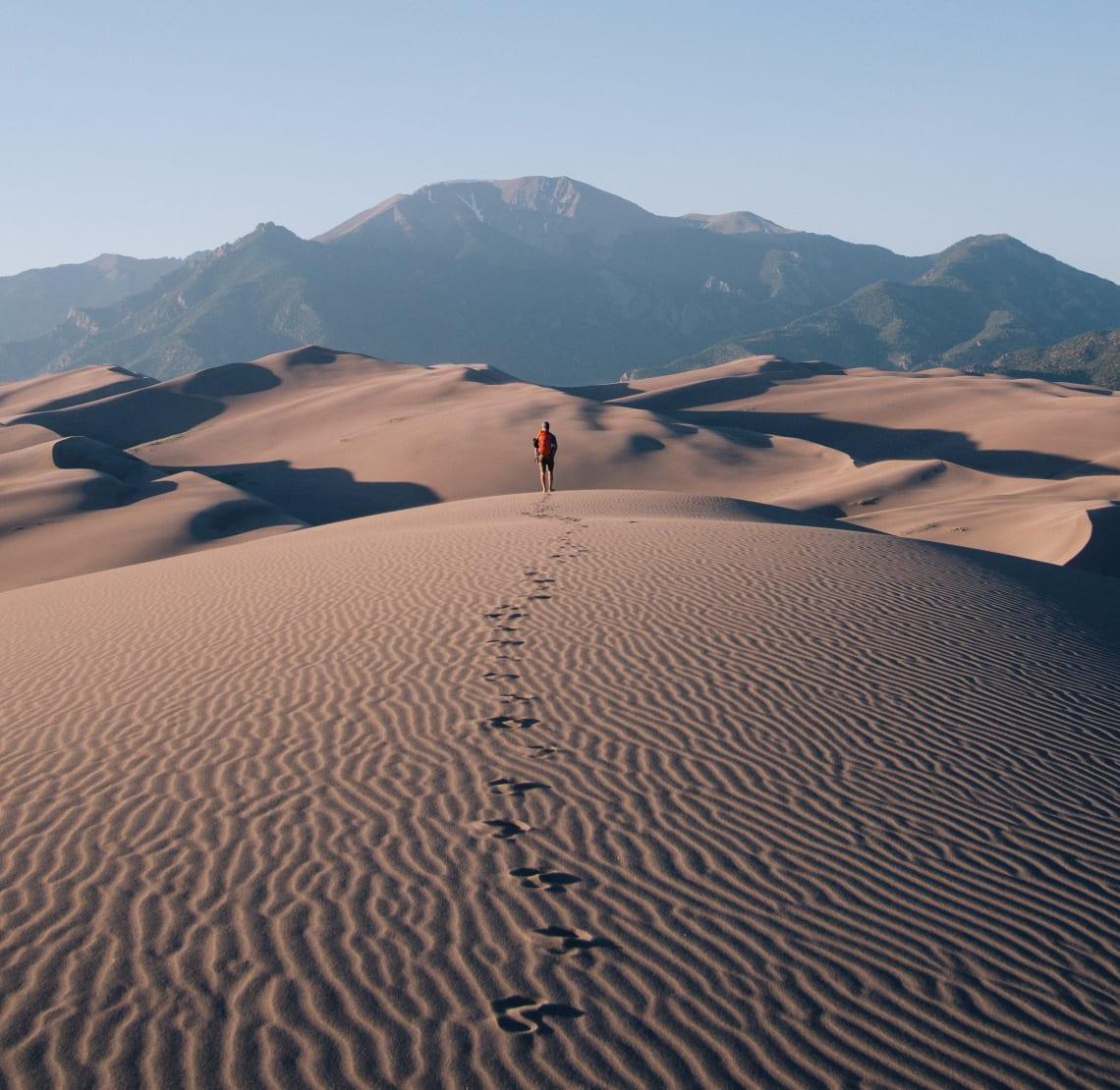 Solo traveler exploring a desert landscape