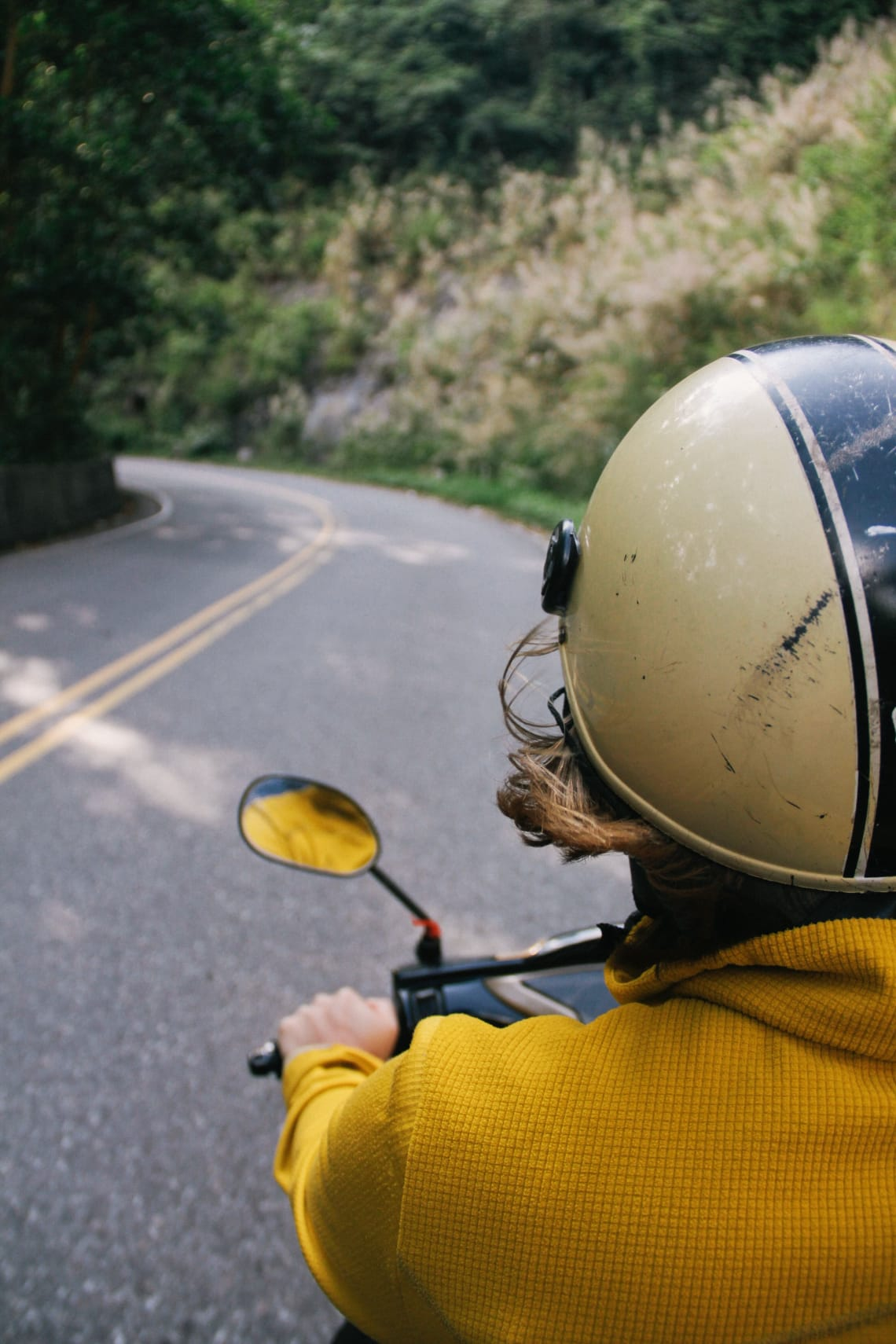 Slow travel: adventurer on a scooter