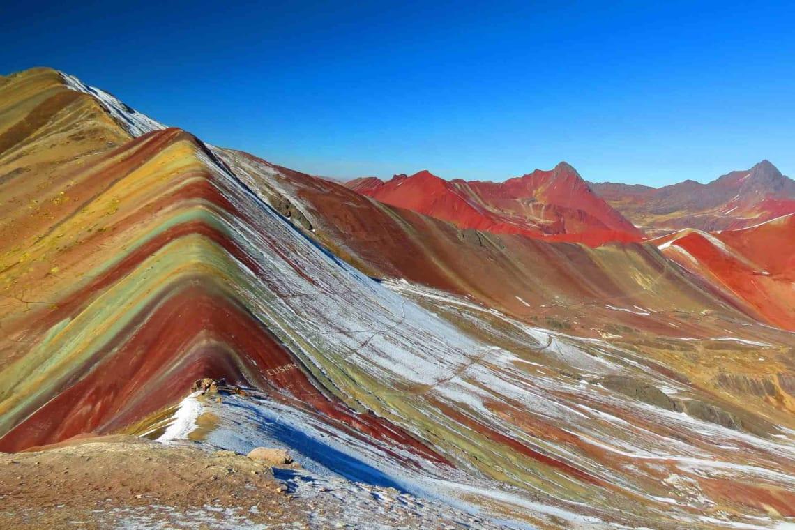 Lugares baratos para viajar en Perú - Worldpackers - vinicunca