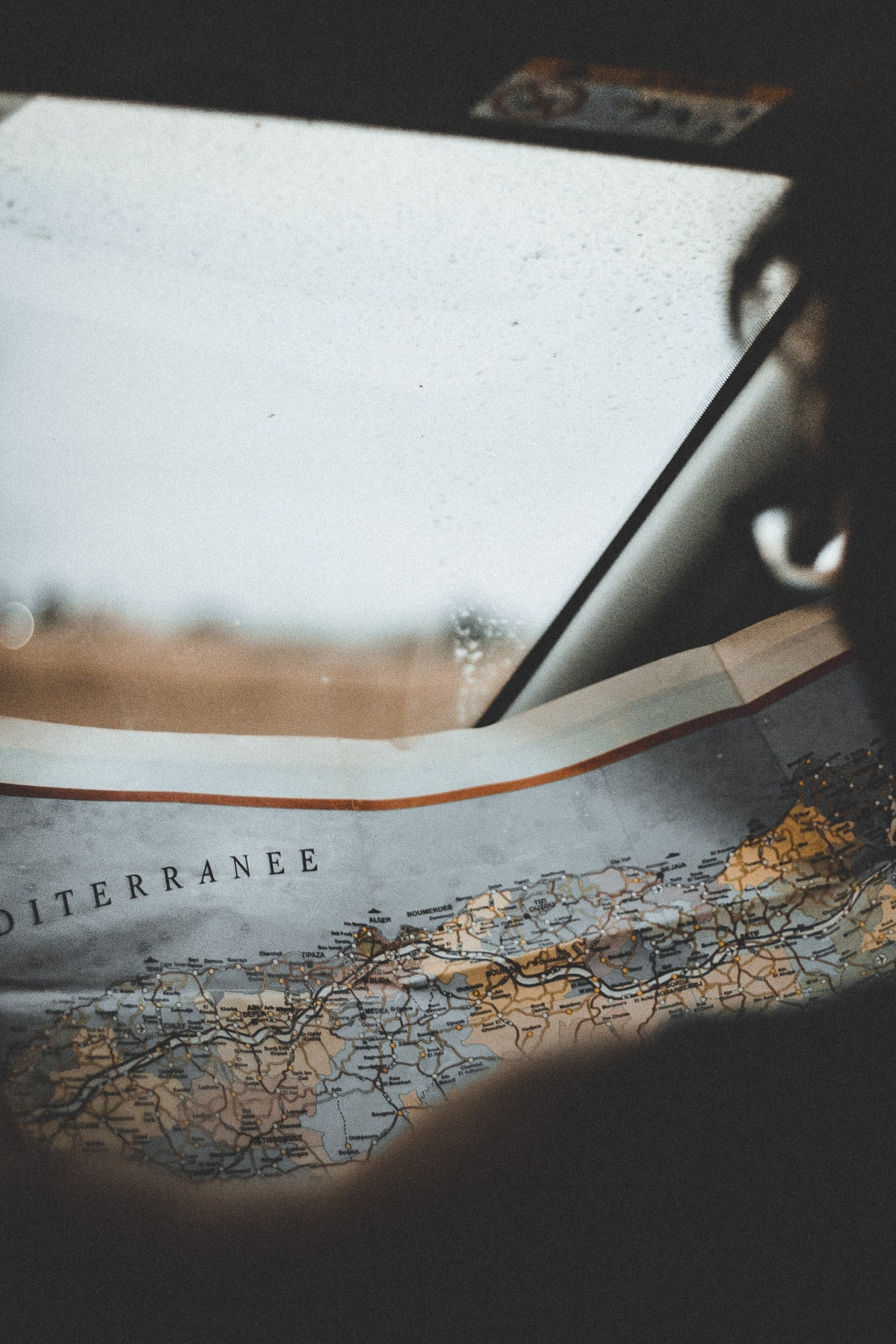 Traveler looking at vintage map