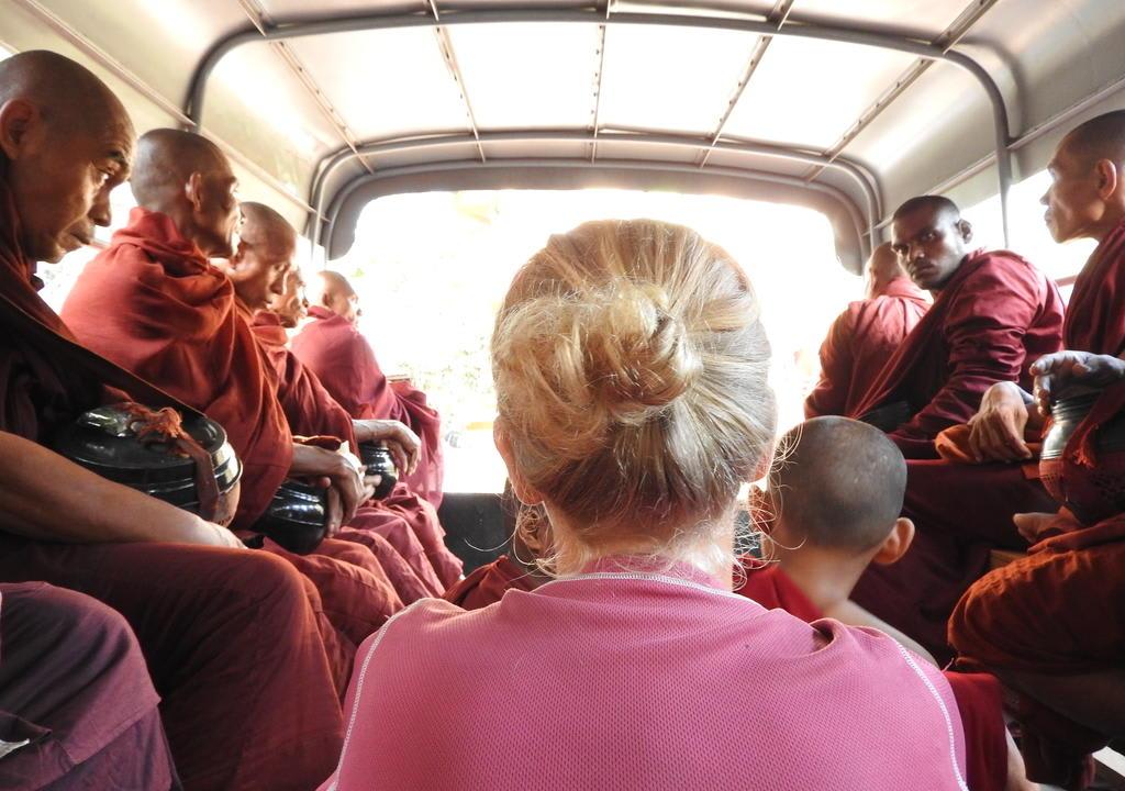 volunteer taking bus with monks in Nepal