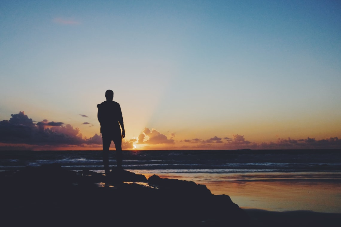 Male silhouette on the beach at sunset, Tarifa, Spain