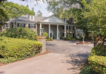Stunningly Renovated Quintessential Main Line Stone Estate with Tennis Court