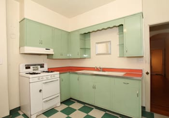 Girard Estates fixer-upper with stained glass and retro kitchen wants $230K
