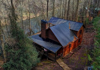 JUST LISTED!  ESTABLISHED RIVER-FRONT RENTAL CABIN WITH BUILDABLE LOT IN COOSAWATTEE RIVER RESORT