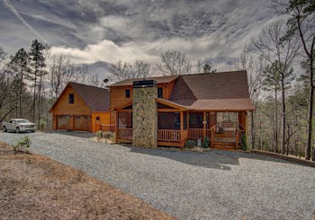 JUST LISTED!  CUSTOM YEAR ROUND MOUNTAIN VIEW LOG CABIN WITH AMAZING OUTDOOR GREAT ROOM IN RIDGE BROOK COMMUNITY!