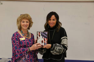 Sherry Ridge poses with Michele Metz with Hometown Hero plaque