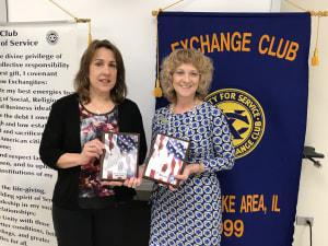 Sherry Ridge and Danielle Theobald present Hometown Hero plaques