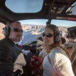 wedding couple in helicopter