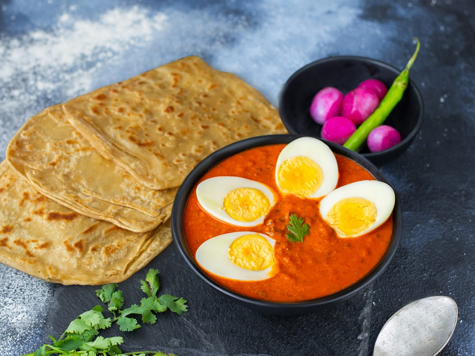 Masala Egg Curry & Tawa Paranthas Meal
