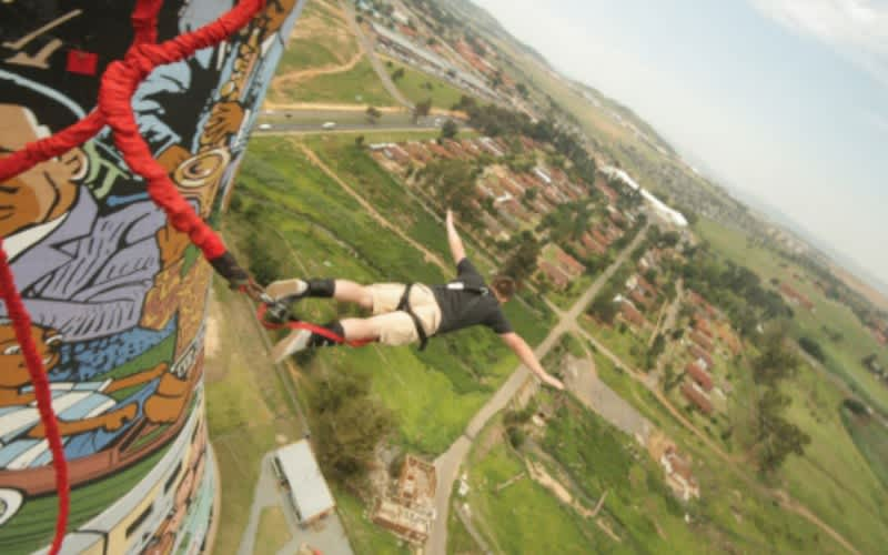 Soweto Towers 100M BUNGEE JUMP - Jump from our suspension bridge with a rubber cord around your feet