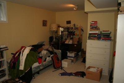 clutter mess basement room before