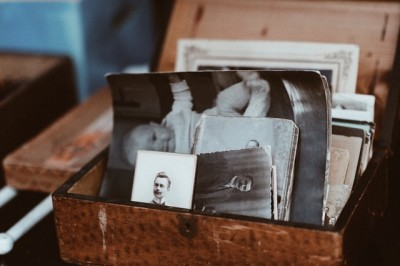 photos belongings old family  sentimental collections boxes piles clutter