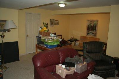 basement clutter mess furniture before