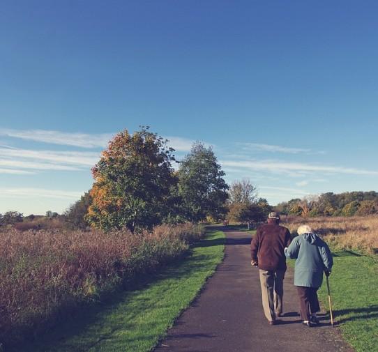 Walking seniors outdoors parks activities fresh air sunshine