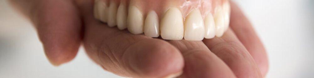 Should You Get Dentures or Dental Implants?
