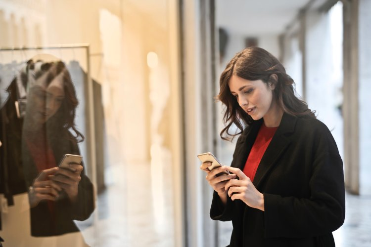 Women checking her phone in mall