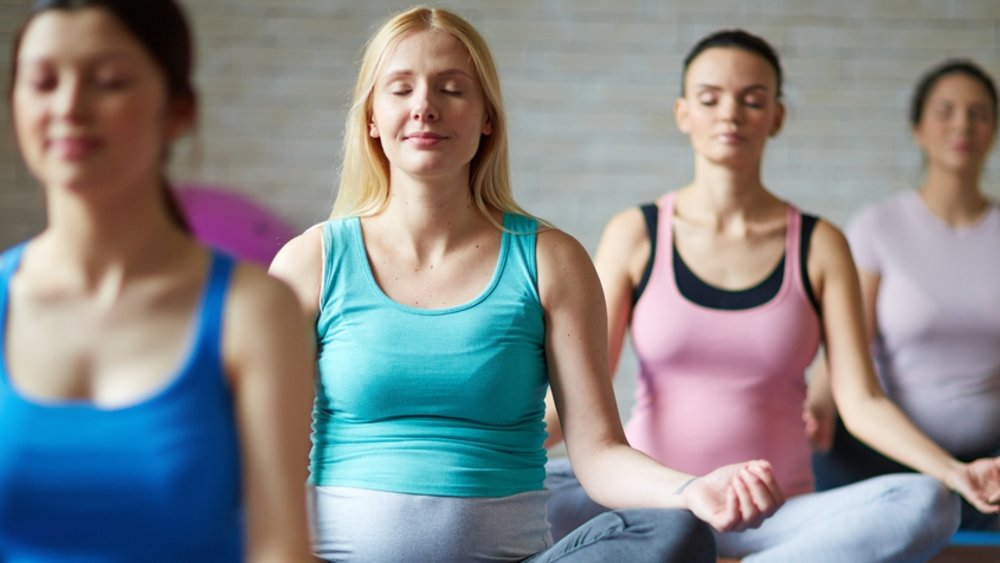 What are the benefits of yoga for women?