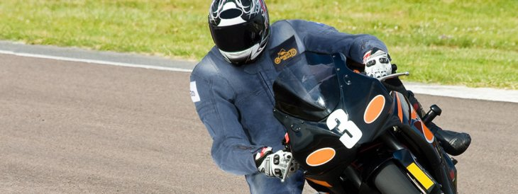 What is the importance of motorcycle racing track suits