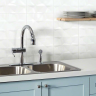 A ceramic tile backsplash for the kitchen is one of the most popular ways to decorate the work area, which protects the wall from liquid drops and dirty water.