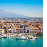 Catania, a city situated on the east coast of Sicily, is famous for being close to Mt. Etna, still considered to be an active volcano.