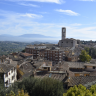 Perugia, a city in Italy, the Umbria region's capital, is most well-known for its defensive walls surrounding the area.