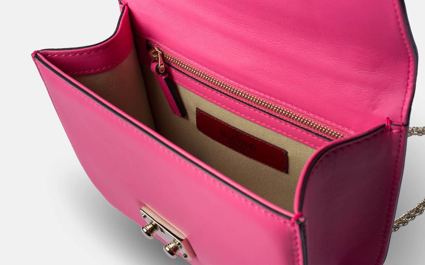 Valentino_Lock_Mini_Crossbody_Pink_Shoulder_Bag_Perspective-min