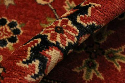 3x4 Red/Moss Kazak Rug close-up and folded