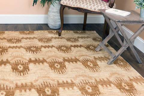 6x9' neutral Ikat wool area rug in room with table and chair