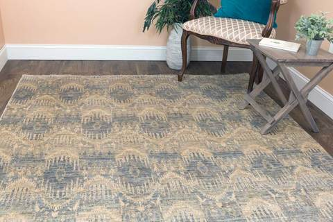 6x9' grey Ikat wool area rug in room with table and chair