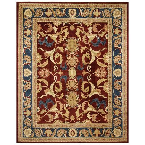 Intricate rug red blue and tan
