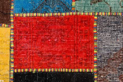 5x7 Multicolor Overdyed Patchwork Rug Close-up