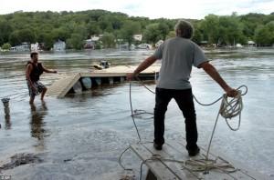 dock damaged by Hurricane Irene, needs deicer