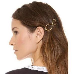 Hollow bow-shaped gold alloy hairpin
