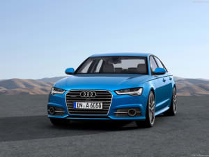 Audi A6 on hilly background